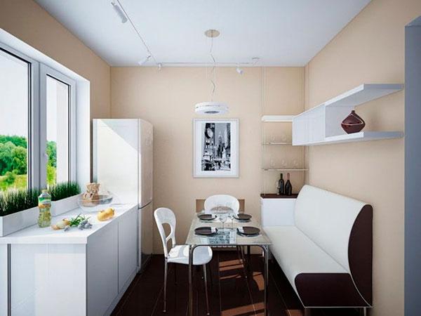 Обеденная зона с диваном в прямоугольной кухне