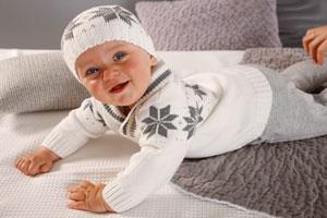 Вязаная одежда для новорожденных спицами